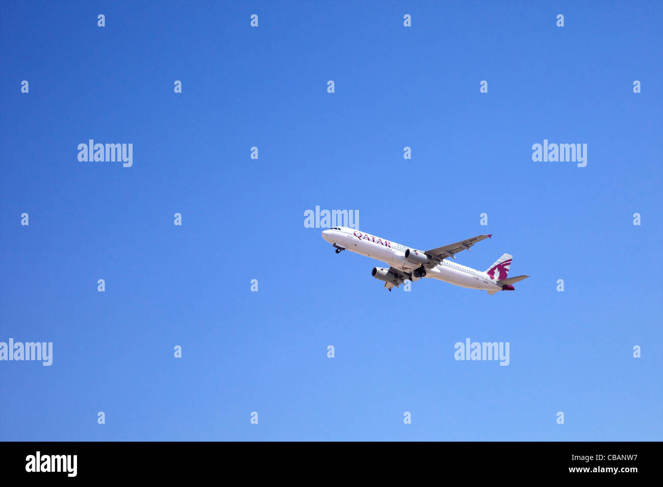 Qatar airliner Airbus A330 aircraft in flight shortly after take-off from Doha International Airport - Stock Image