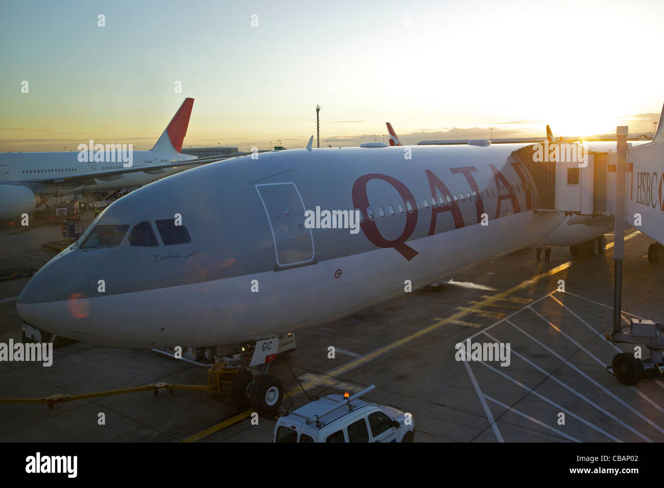 Qatar Airways Airbus A330 aircraft, parked on stand at Heathrow Airport, London, UK, United Kingdom, GB, Great Britain, - Stock Image