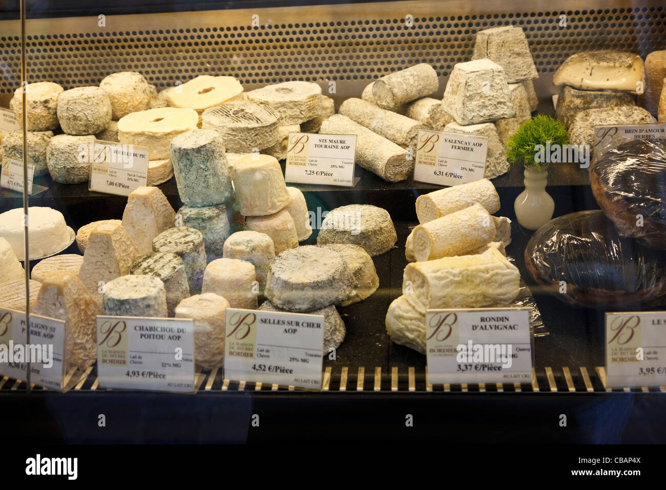 French cheese window display in a shop in France - Stock Image
