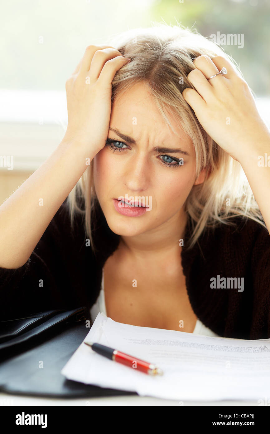 Woman stressed in office - Stock Image