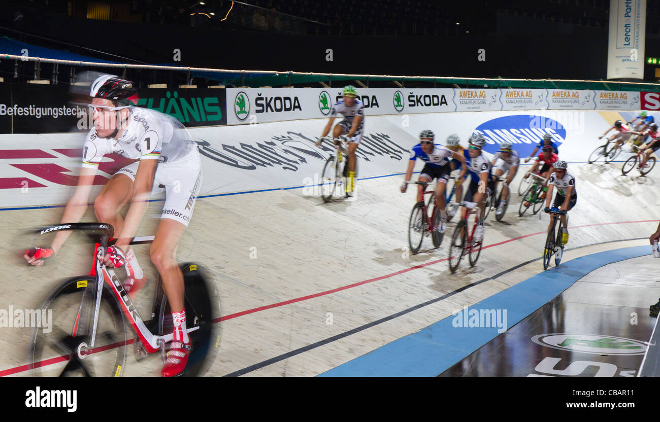 Professional athletes fight for victory at indoor bike challenge Sixday-Nights Zürich 2011 at Zurich Hallenstadion - Stock Image