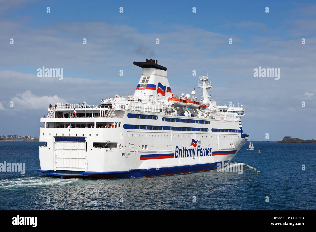 Brittany Ferries passenger ferry sailing out of St Malo harbour, France - Stock Image