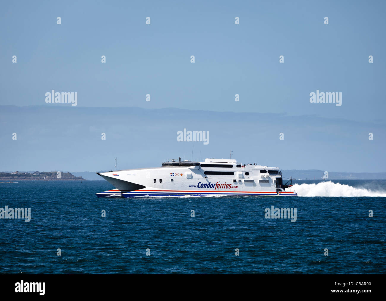 Condor Ferries catamaran coming into Saint Malo harbour, Brittany, France - Stock Image