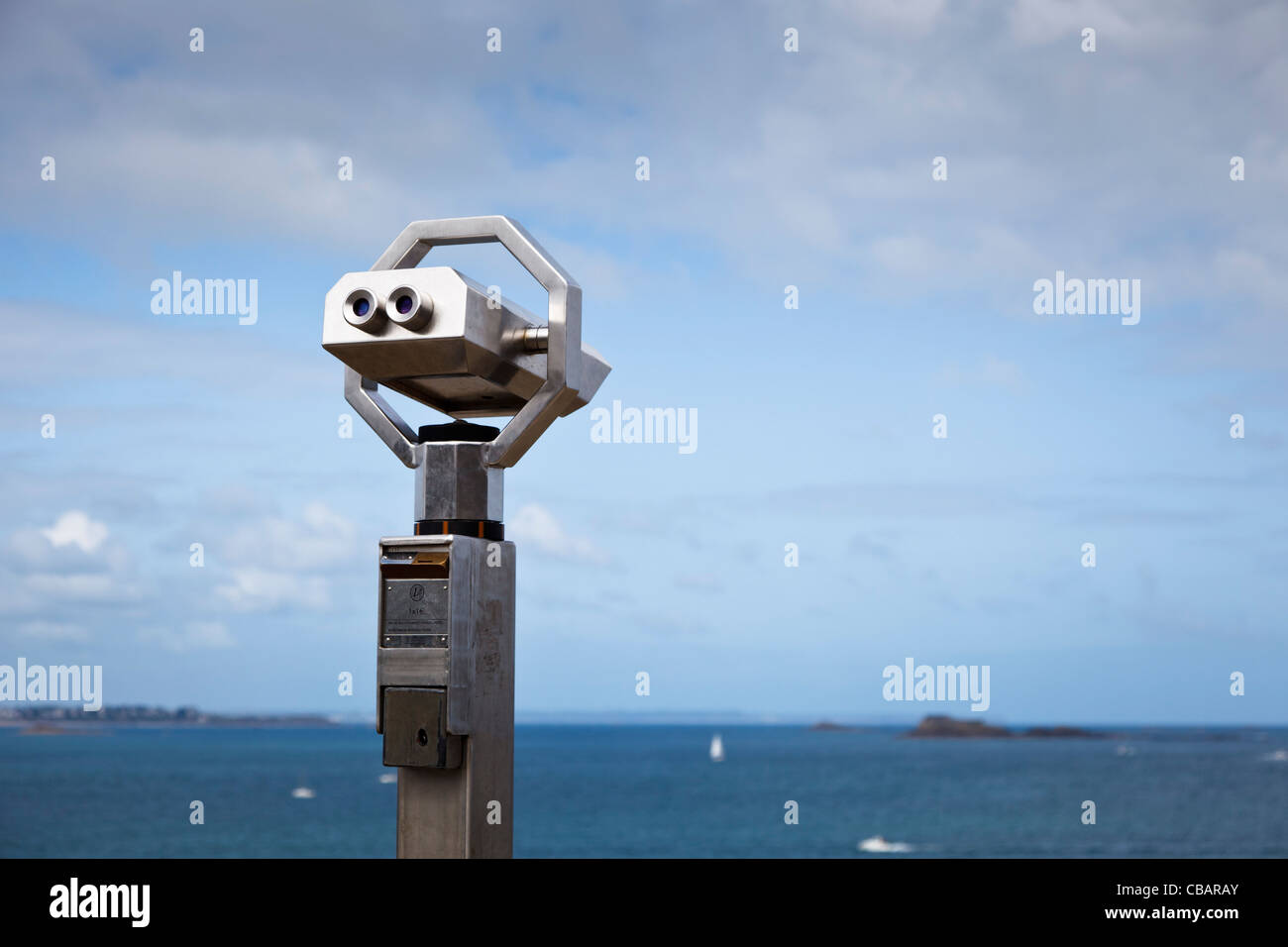 Telescope overlooking the bay at a coastal town in france - Stock Image