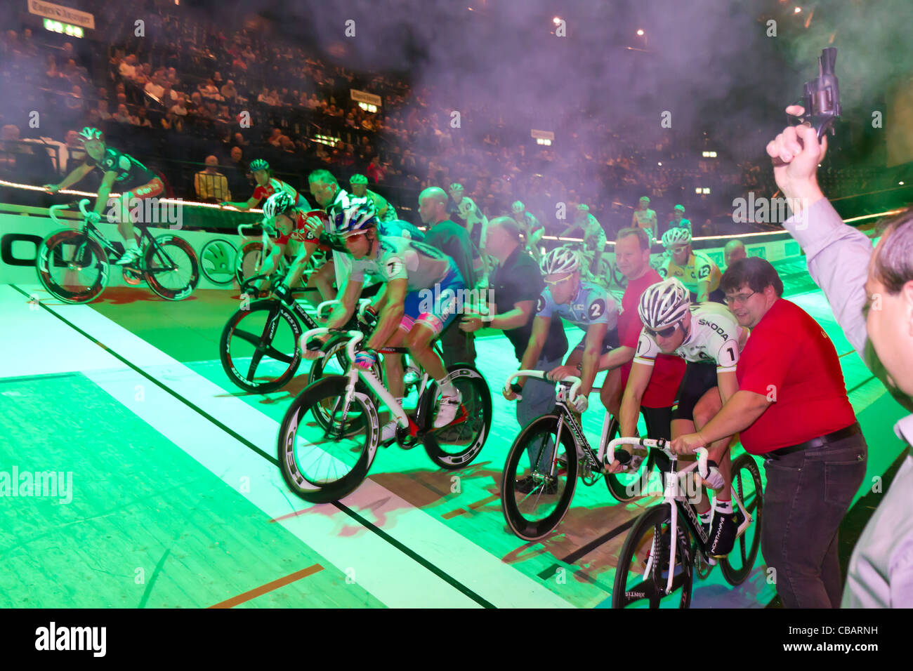 Professional athletes start a race at indoor bike challenge Sixday-Nights Zürich 2011 at Zurich Hallenstadion - Stock Image