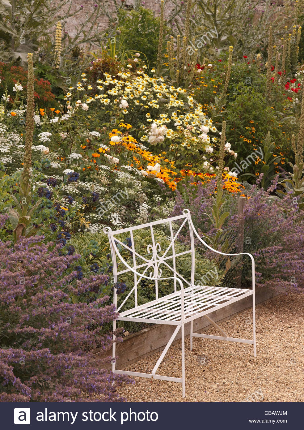 Remarkable Ornate White Metal Bench Seat In Front Of Flower Bed Border Ocoug Best Dining Table And Chair Ideas Images Ocougorg