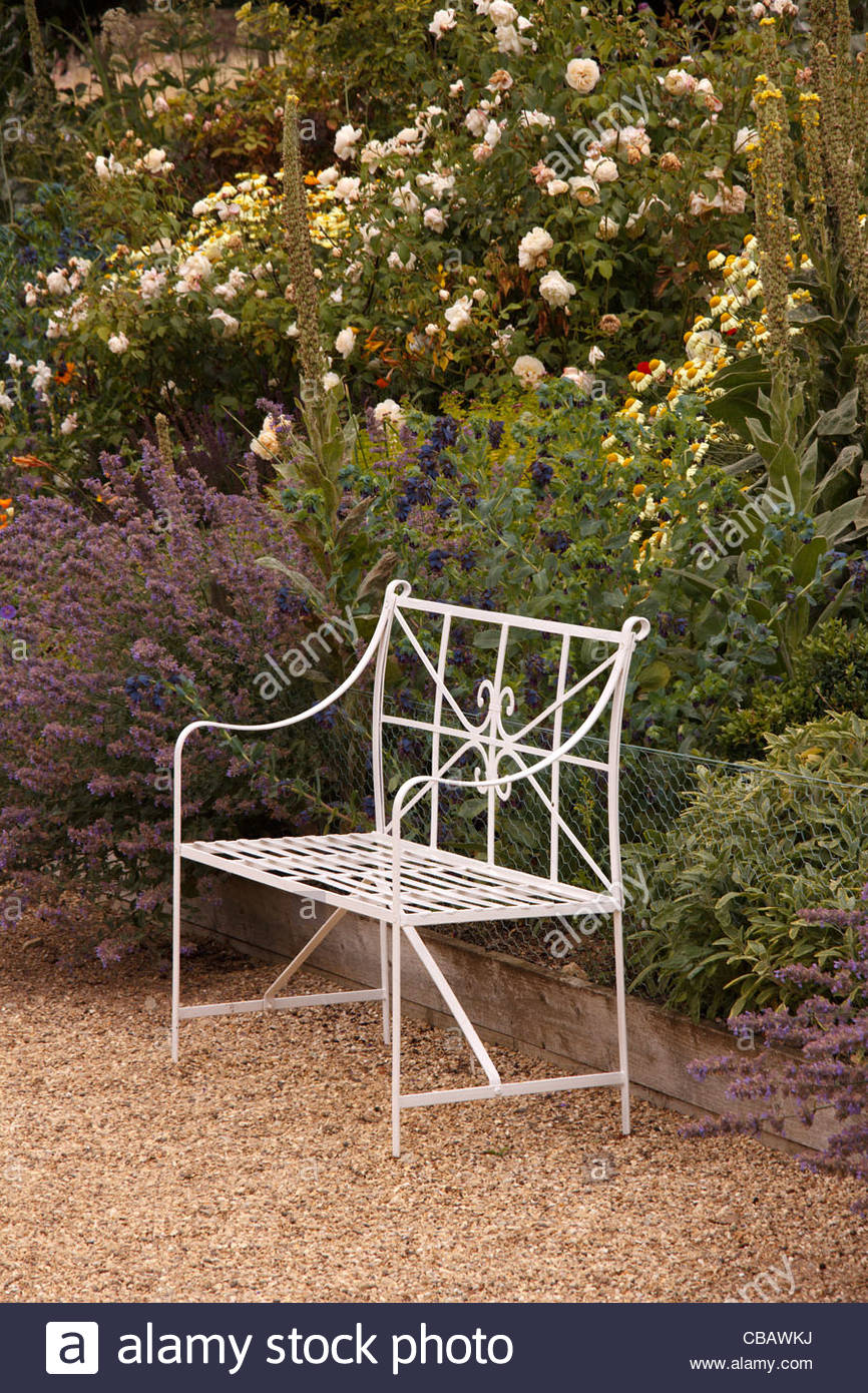 Admirable Ornate White Metal Bench Seat In Front Of Flower Bed Border Ocoug Best Dining Table And Chair Ideas Images Ocougorg
