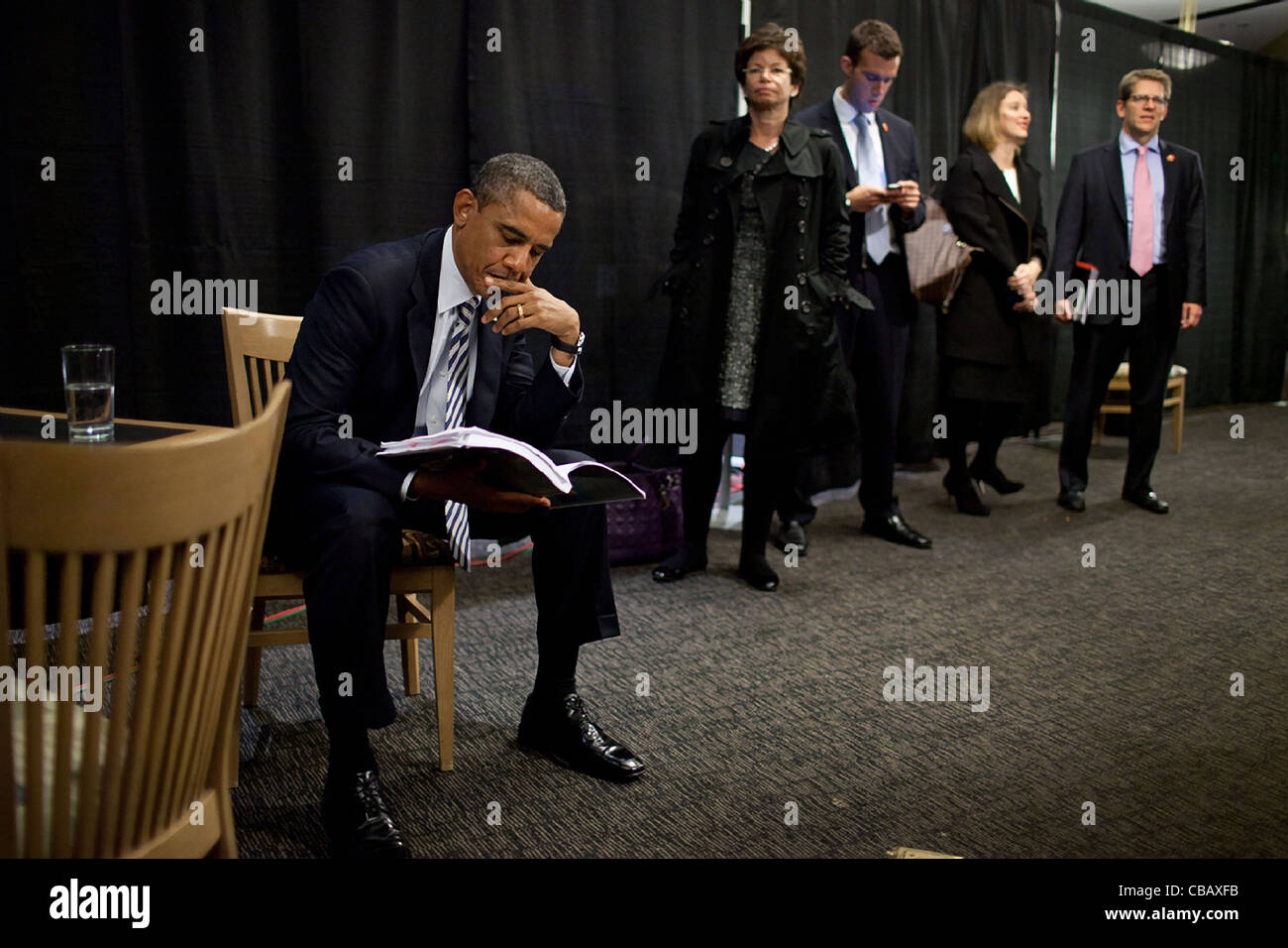 President Barack Obama waits with staff backstage before an event at the Pepsi Center in Denver, Colo., Oct. 25, - Stock Image