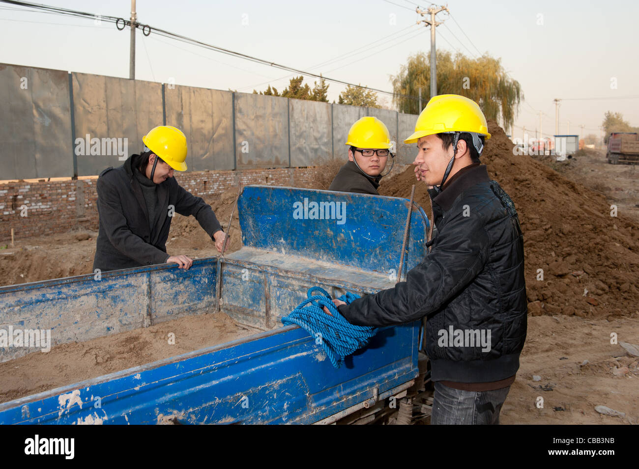Construction workers at work Stock Photo