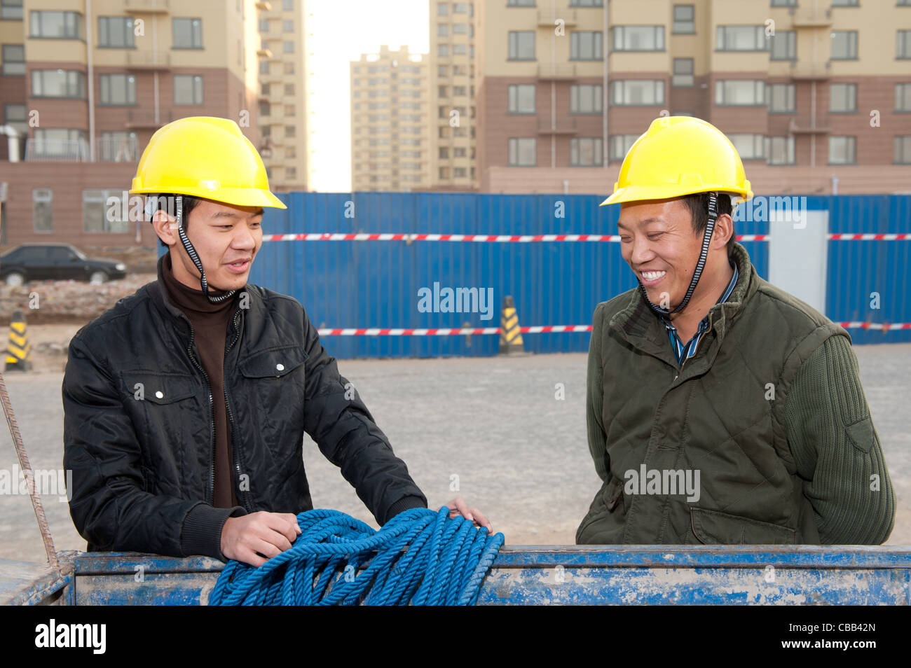 Construction workers chatting while at work Stock Photo
