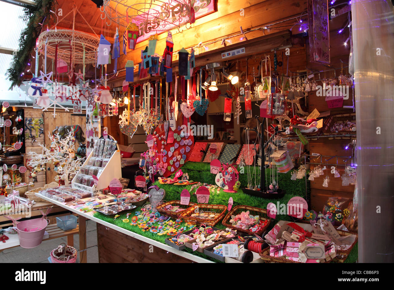 Close up of a colourful stall at Bath Christmas Market, England - Stock Image