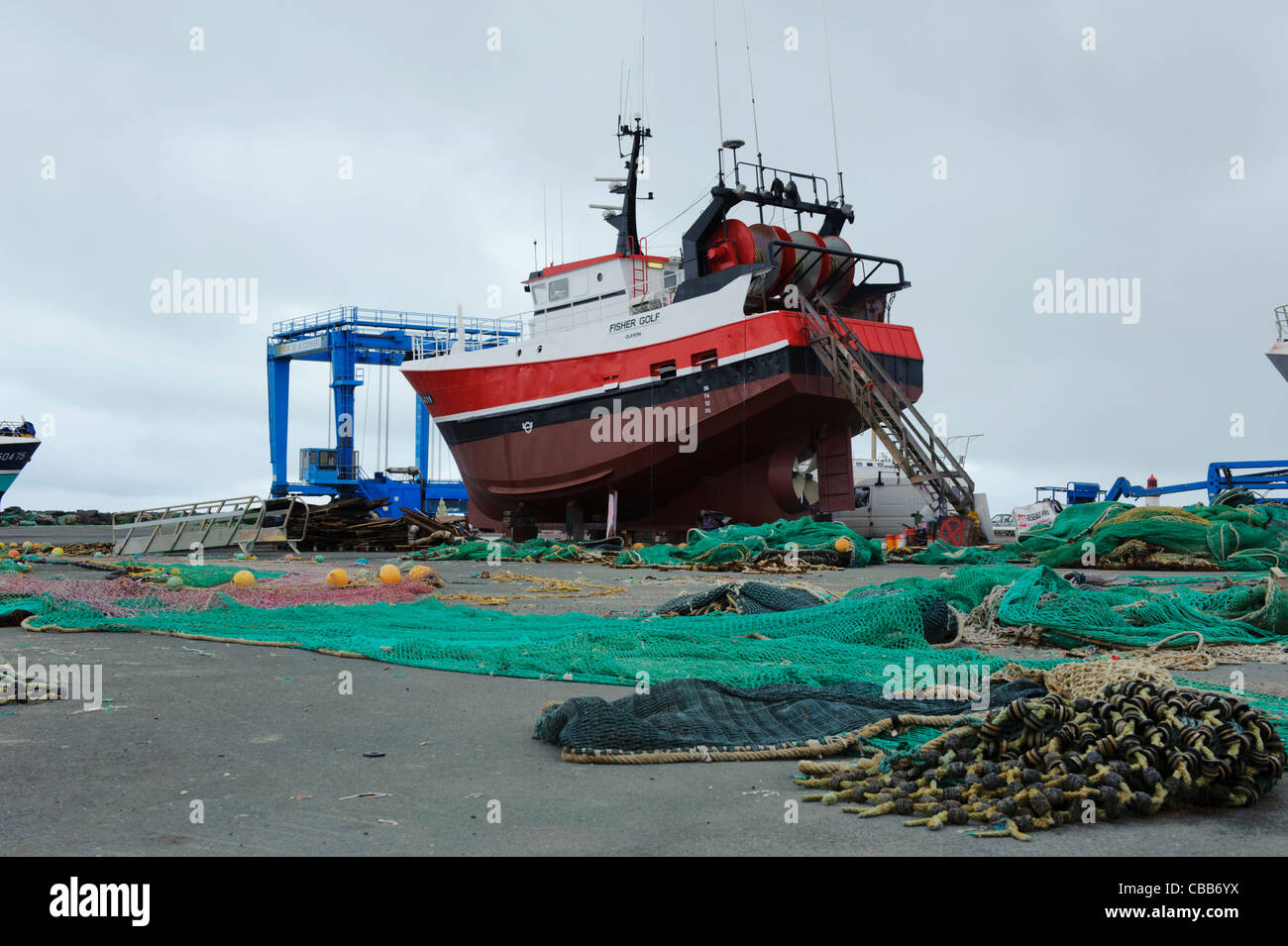 Stock photo of fishing boats in dry dock. - Stock Image