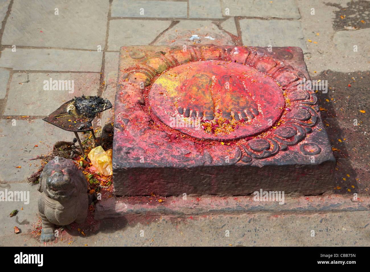 Hindu Stone With Feet And Lotus Flower With Offerings Entrance To