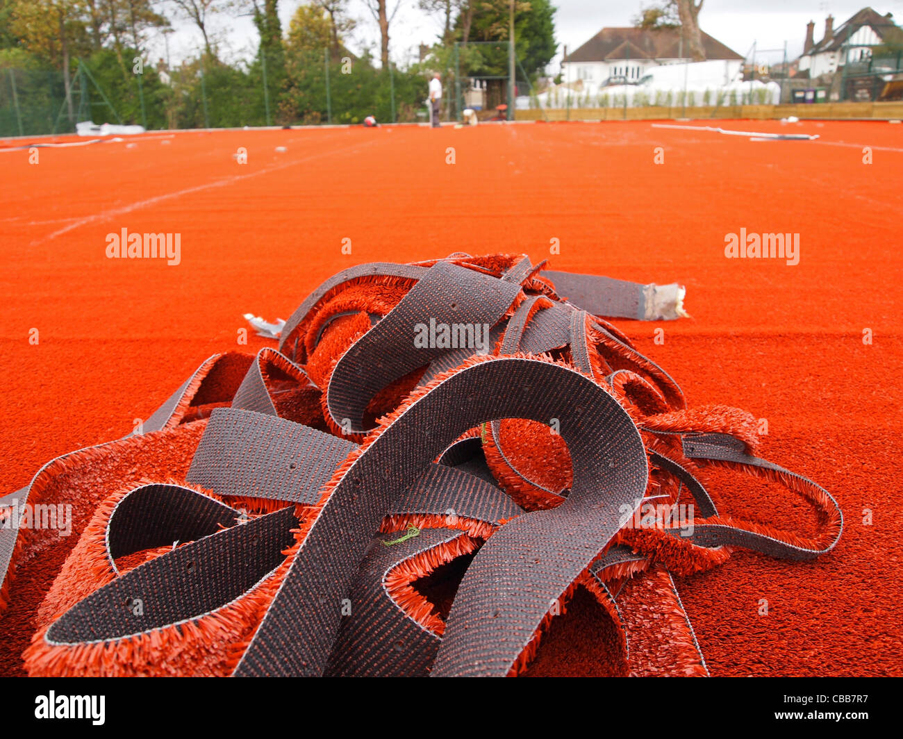 Construction of synthetic clay tennis courts - left-over trimmings of the stability mat - Stock Image