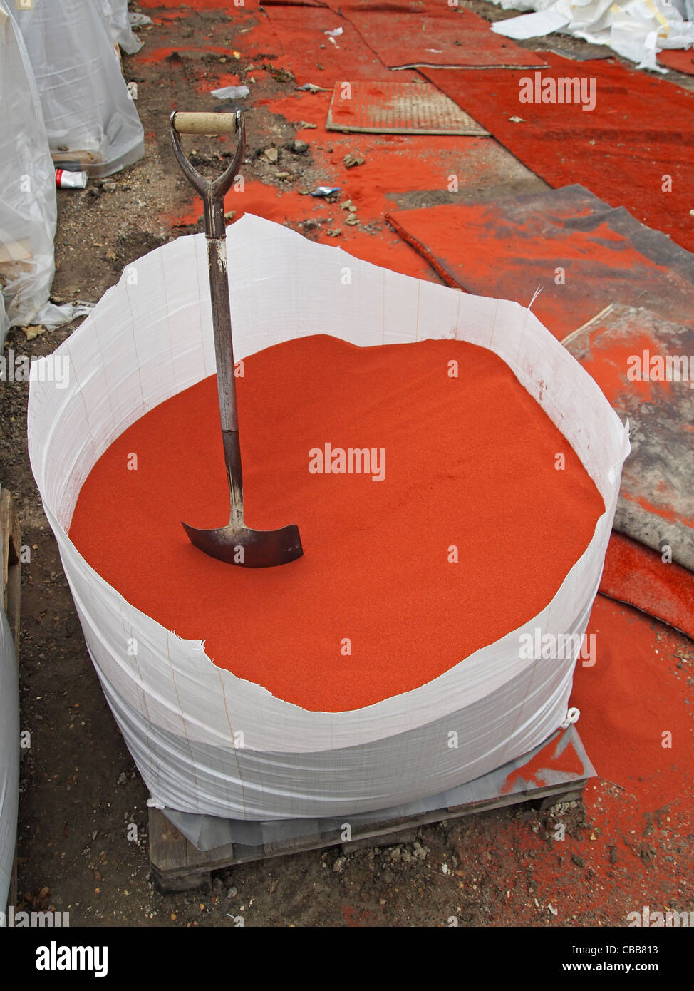 Construction of synthetic clay tennis courts -  a bag of the clay top layer - Stock Image