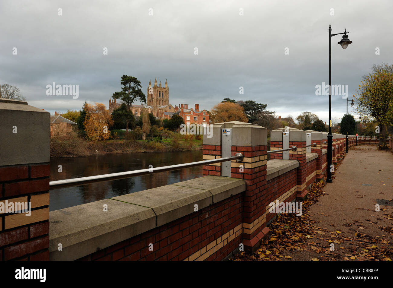 Hereford Cathedral and the flood defence barrier alongside the River Wye - Stock Image