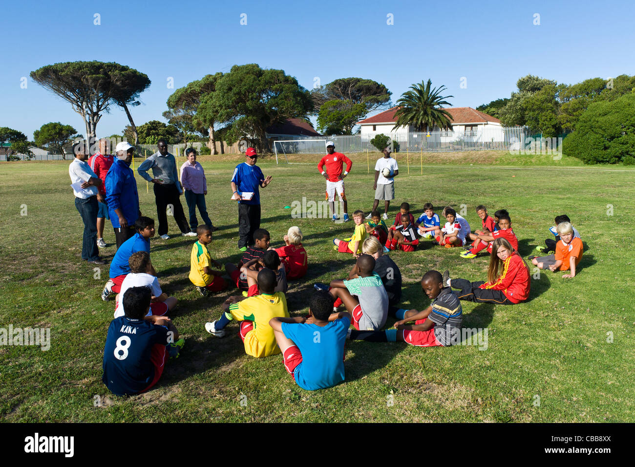 Football coaches instructing a young players during a training session Cape Town South Africa - Stock Image