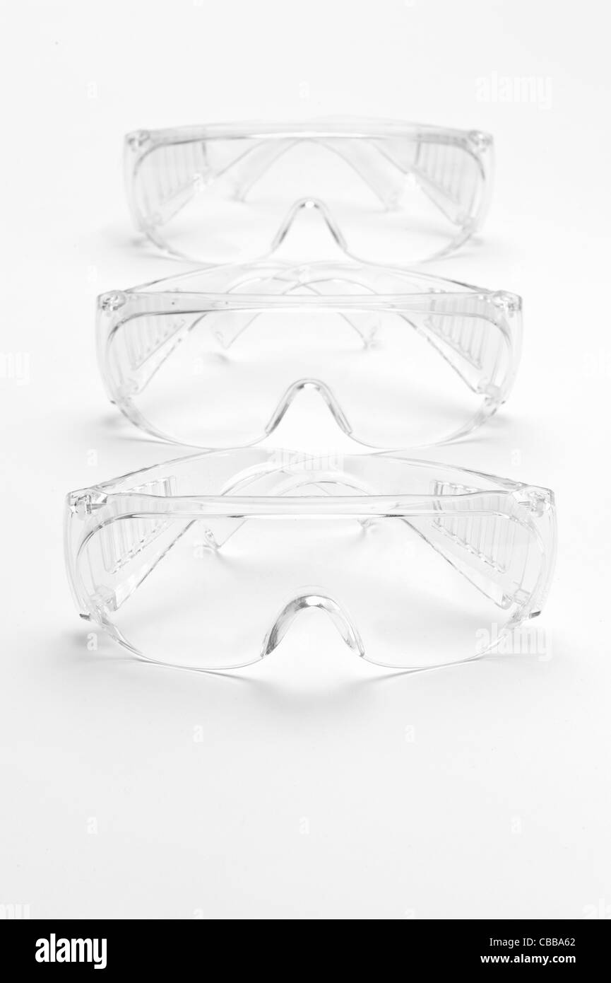Three pairs of safety goggles - Stock Image