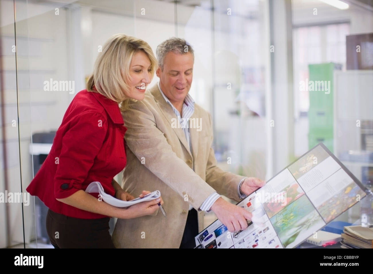 Business people examining project - Stock Image