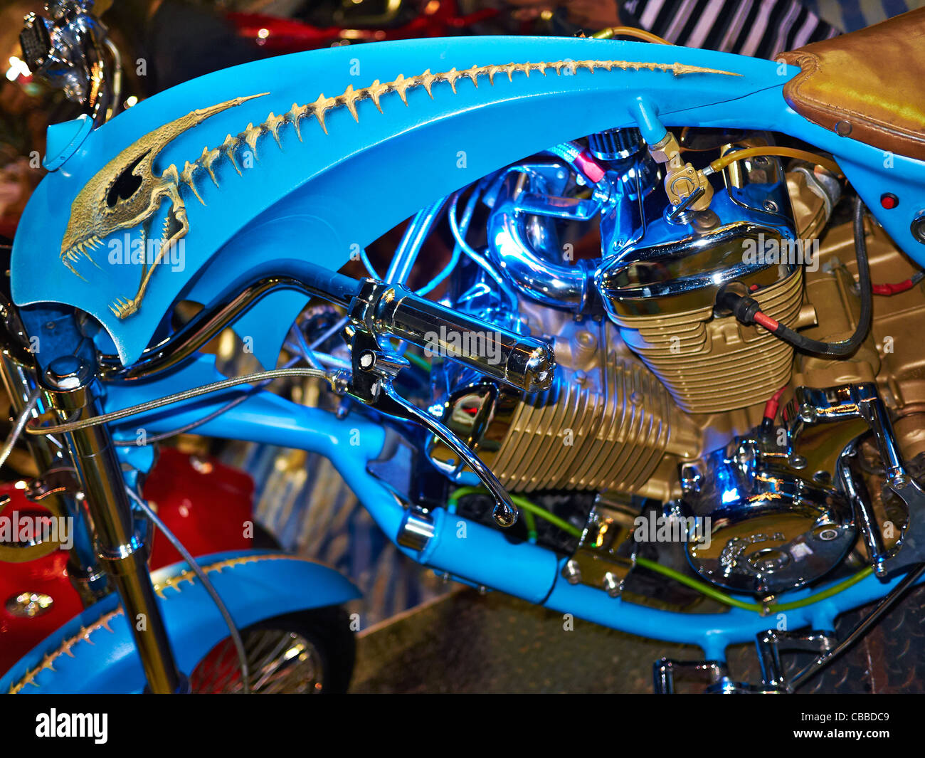Colorful and unusual fuel tank detail of a highly customized, award winning, Honda chopper motorcycle. - Stock Image