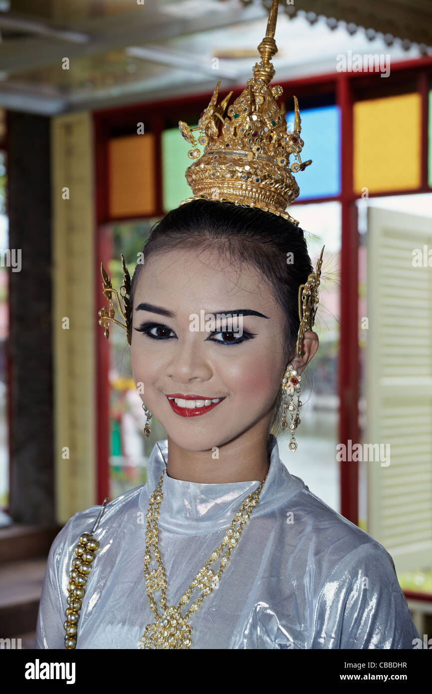 db6ad05a0 Head and shoulders shot of a beautiful young Thailand girl with traditional  attire and crown adornment. Southeast Asia
