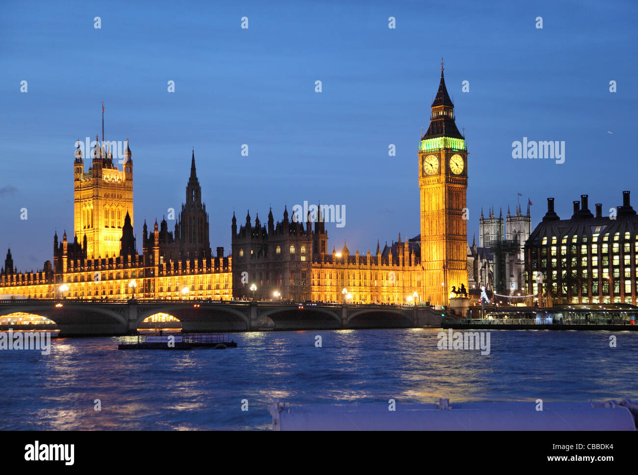 Houses of Parliament, Big Ben, River Thames and Westminster Abbey at night Stock Photo