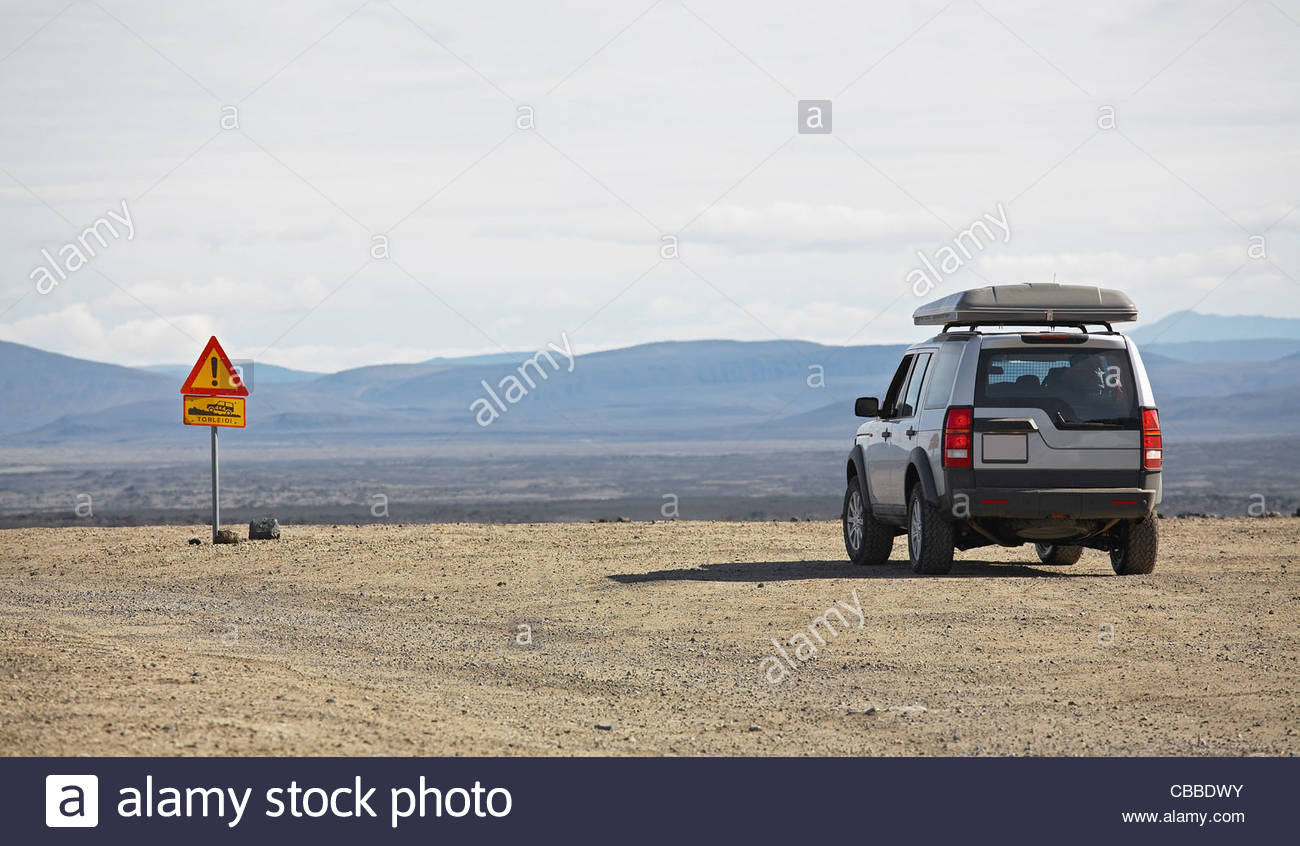 SUV parked on gravel road - Stock Image