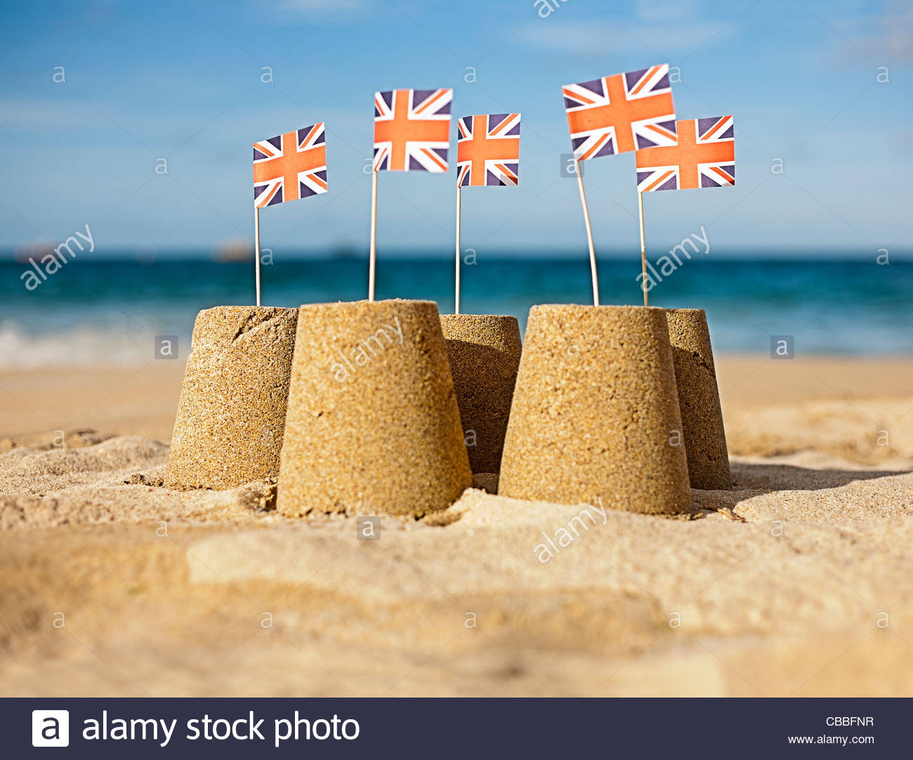Sandcastles with Union Jack flags - Stock Image