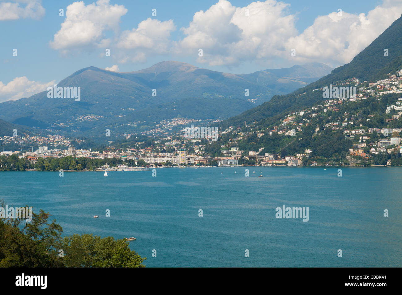 View of Lugano with blue lake in front Stock Photo