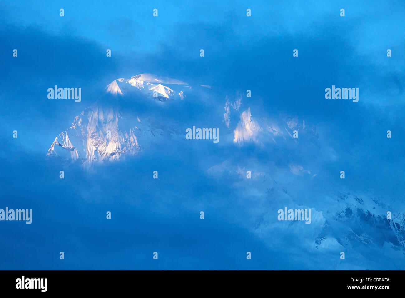 View of summit of Annapurna South from Tadapani, Annapurna Sanctuary Region, Himalayas, Nepal, Asia - Stock Image