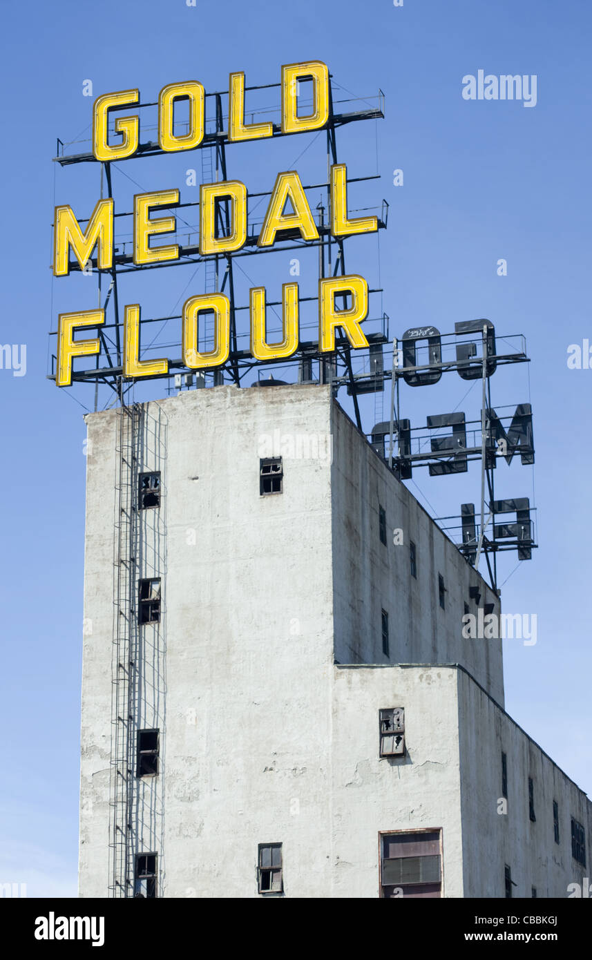 Gold Medal Flour neon sign on a tower of the Mill City Museum in downtown Minneapolis, Minnesota - Stock Image