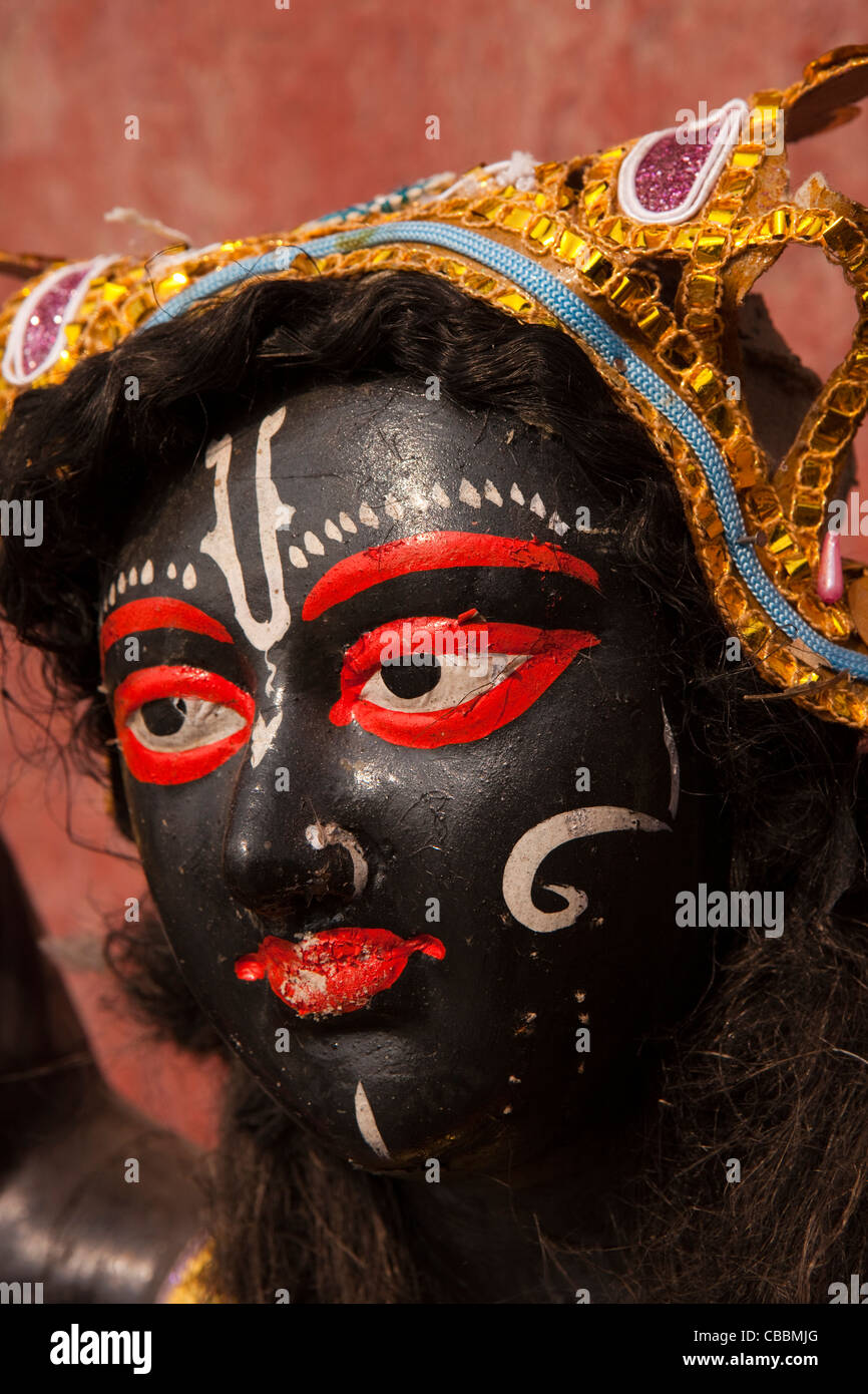 India, West Bengal, Kolkata, Babu Ghat on River Hooghly, decorated clay Jagganath figure used in Hindu religious - Stock Image