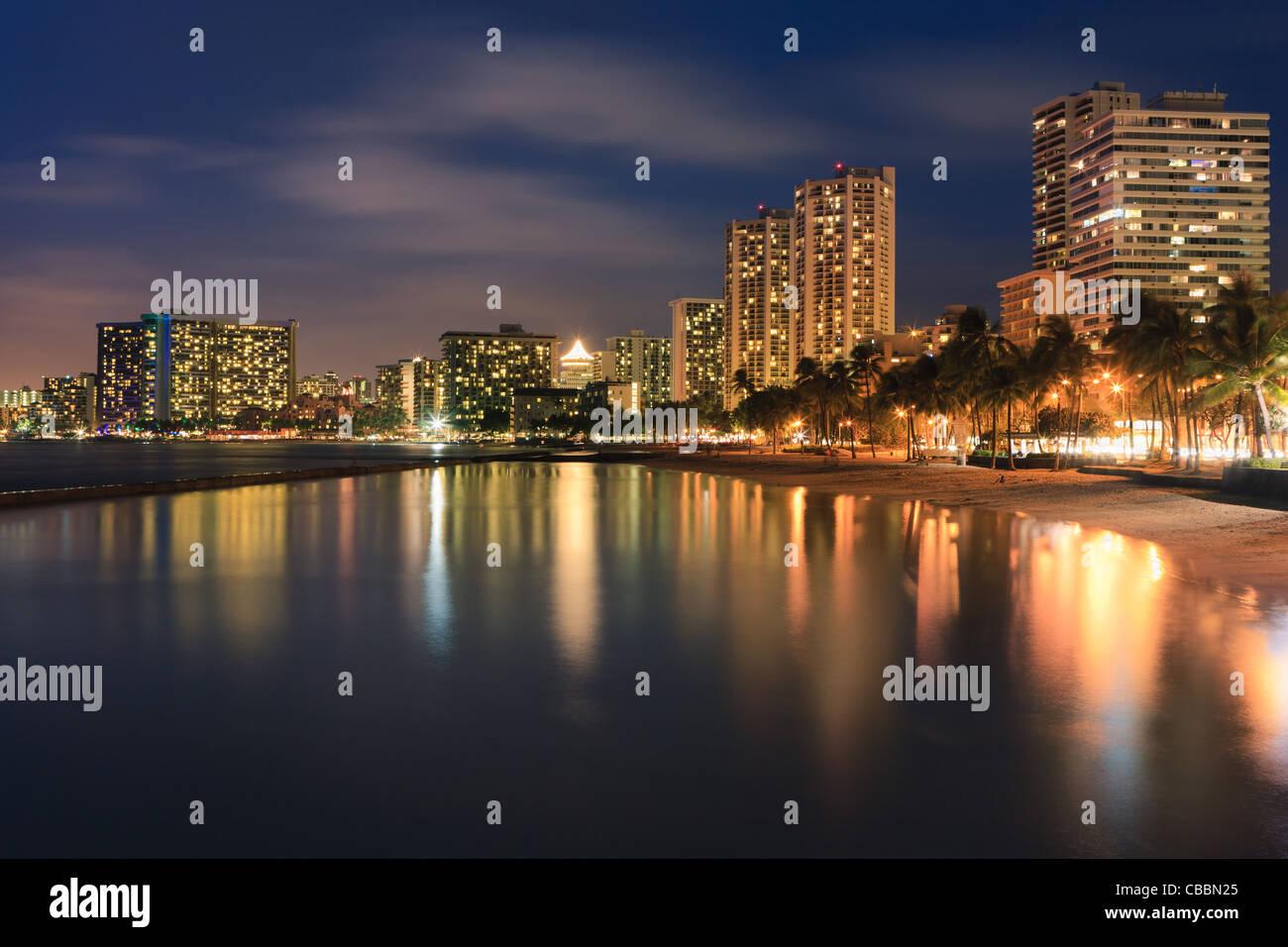 Sunset at famous Waikiki Beach, Honolulu, Oahu, Hawaii - Stock Image