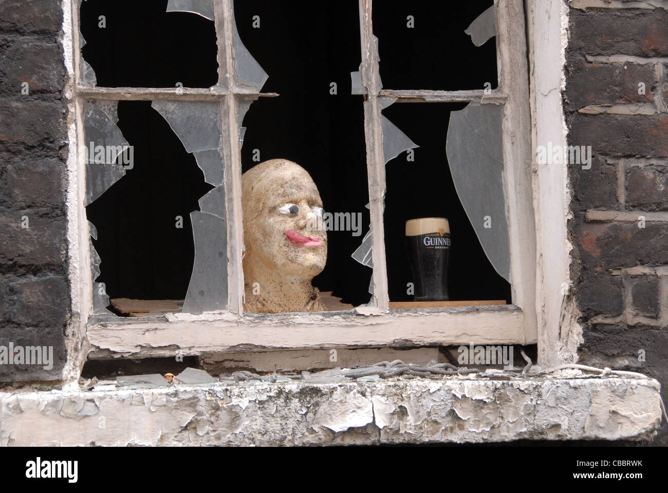 Head and Guinness in a window Dublin Ireland uk - Stock Image