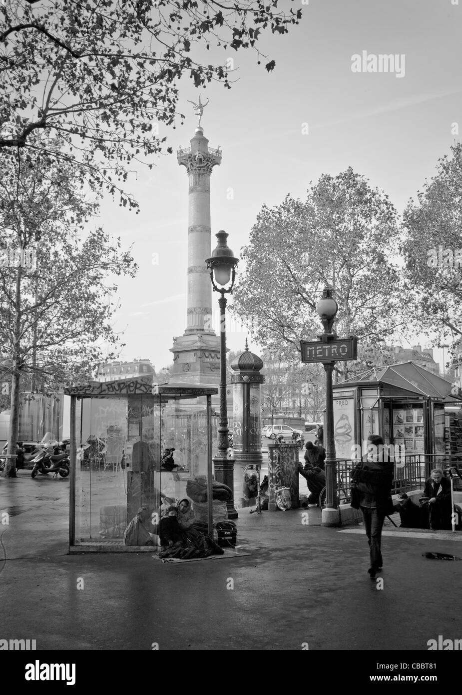 the monuments of Paris homeless,storming of the Bastille., the capture of the phone booth,like the good old days. - Stock Image
