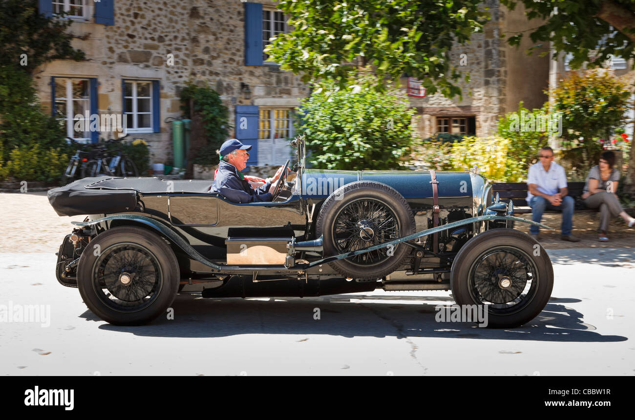 Classic car - vintage Bentley car driving through a village in the South of France - Stock Image
