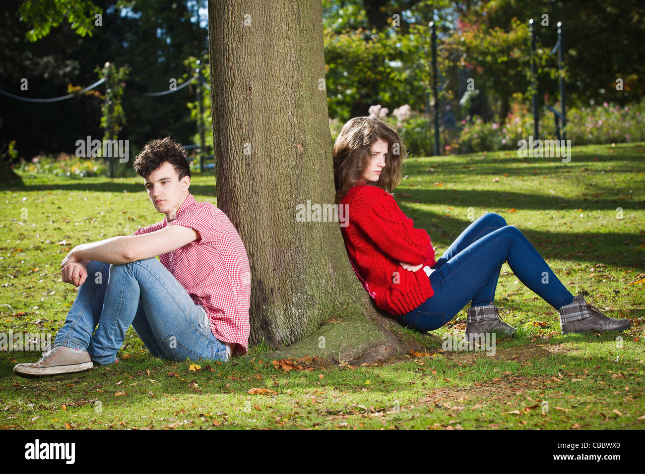 Teenage couple arguing in park - Stock Image