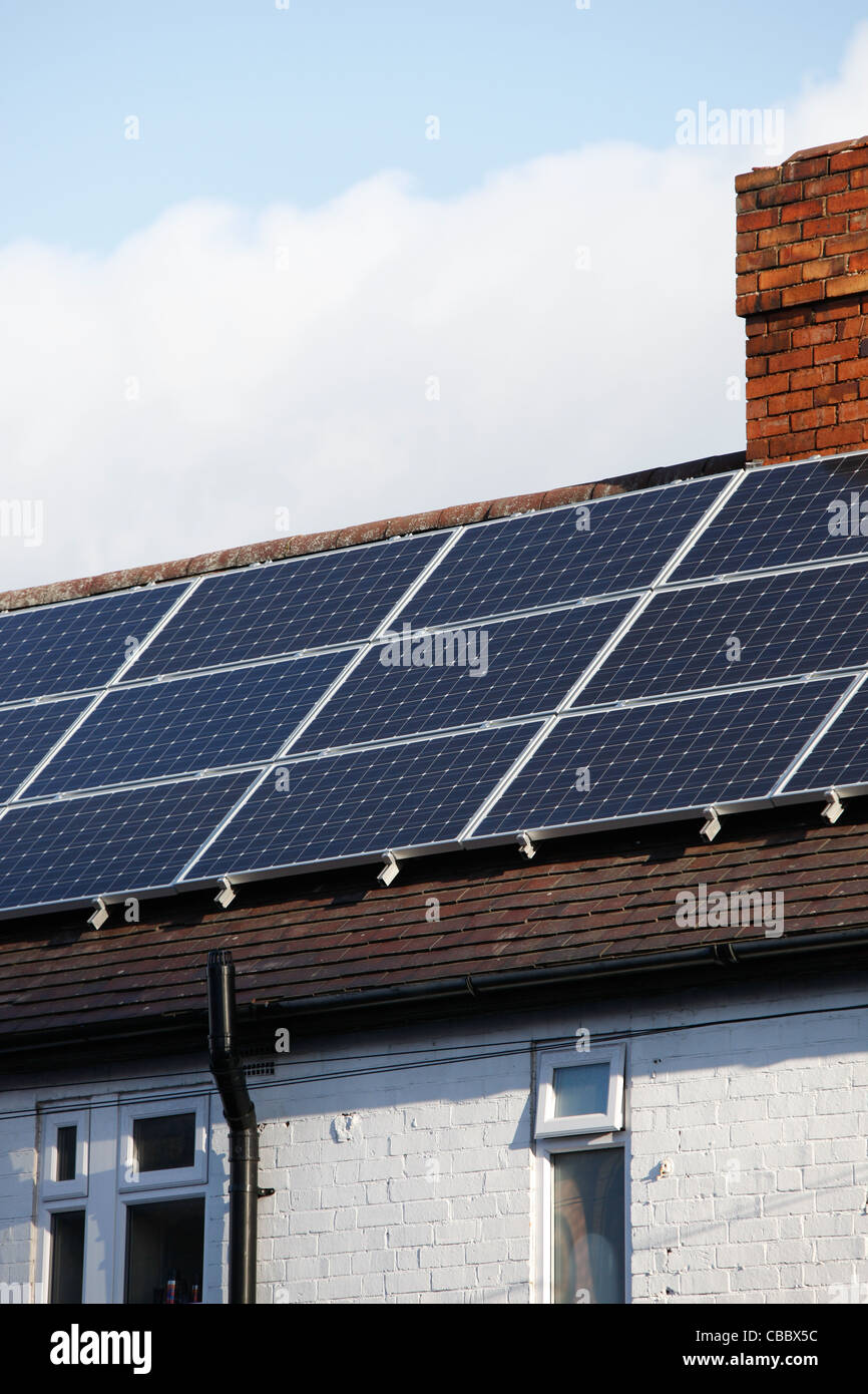Newly installed solar panel array,to generate renewable energy from the sun. Installation is on a pitched roof . - Stock Image