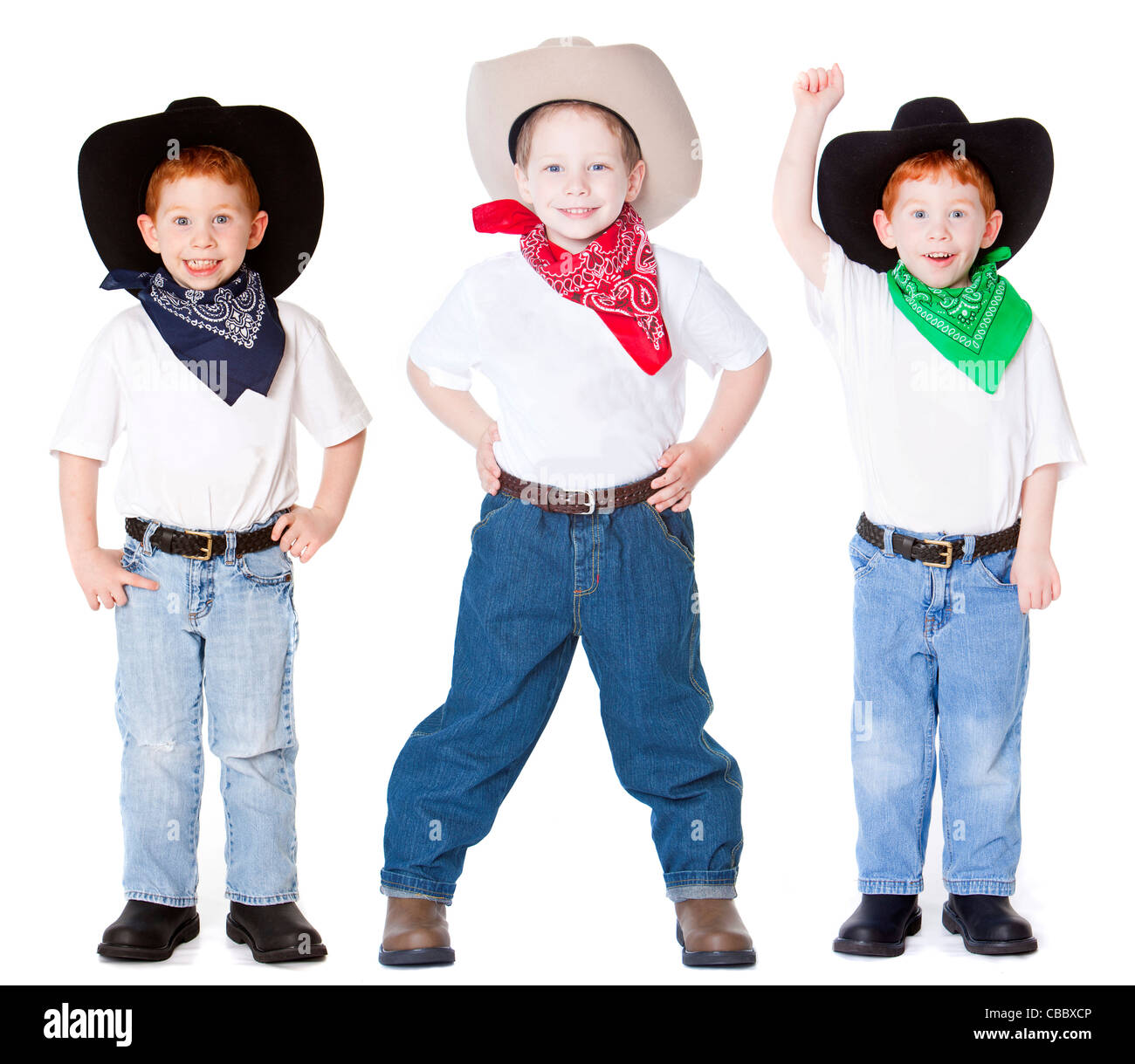 Three boys dressed up as cowboys in studio - Stock Image