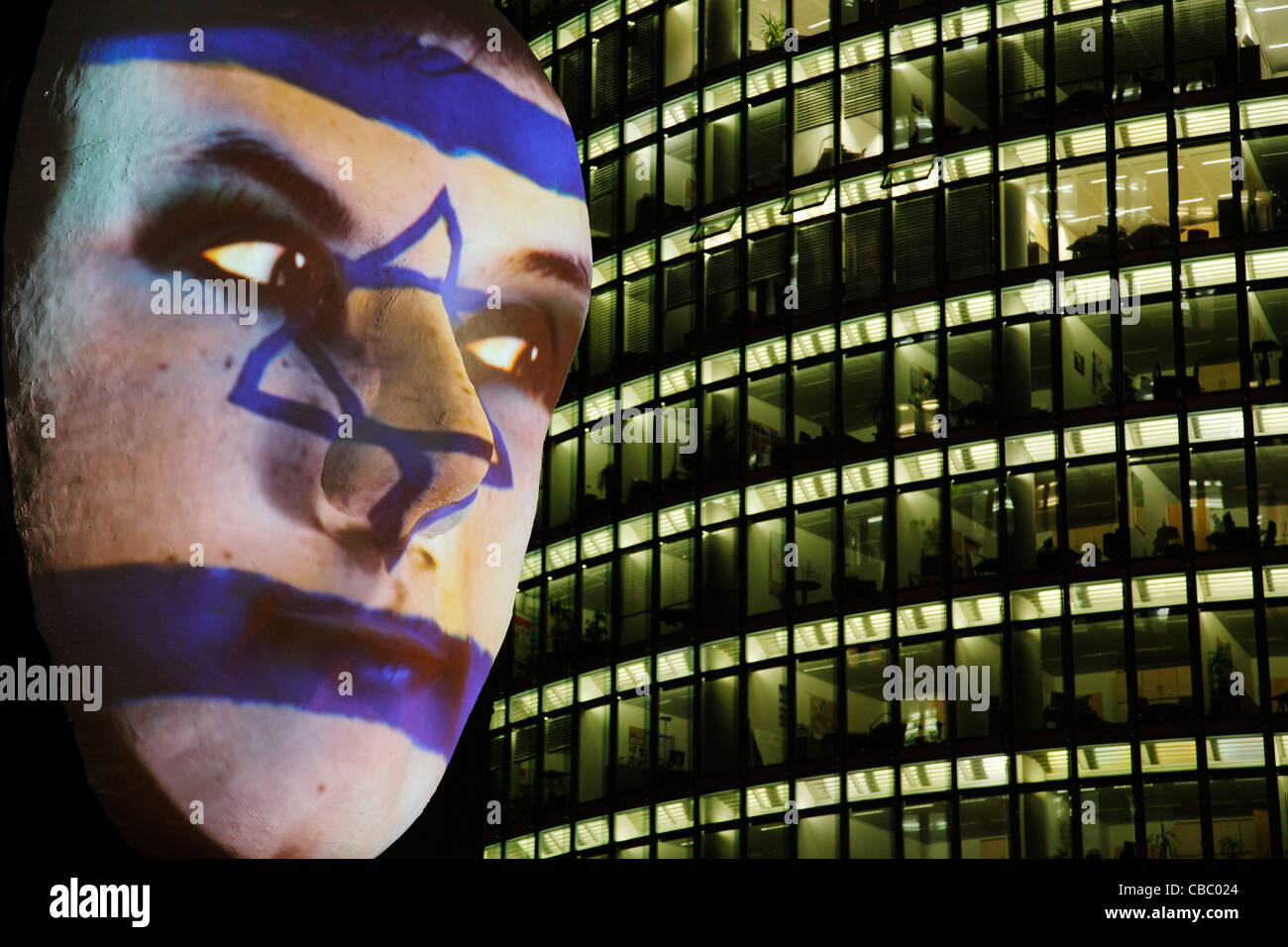 Huge sculpture of a face illuminated by a image of an Israeli flag painted face during the festival of lights 2011 Stock Photo