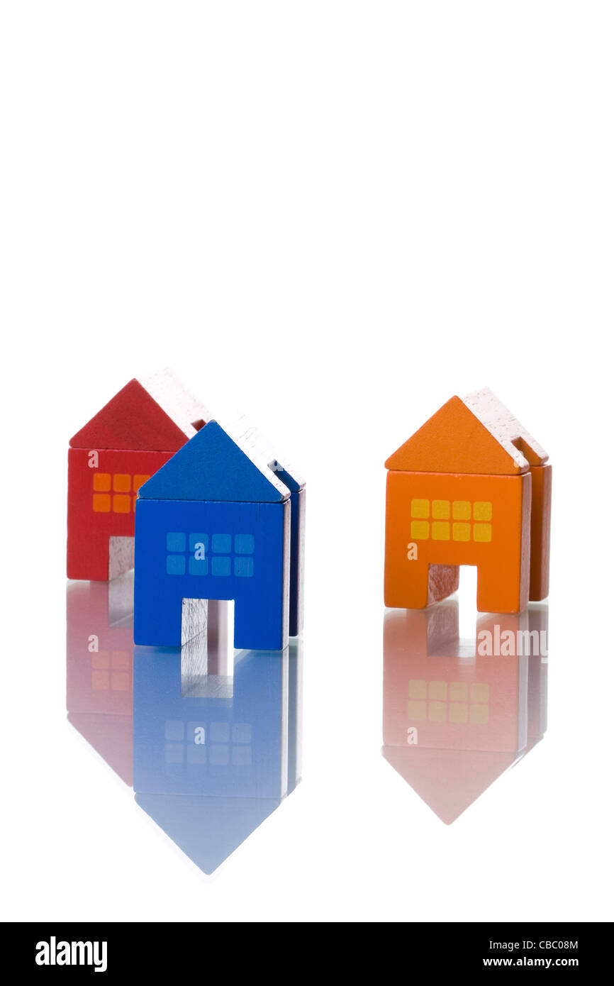 colorful toy houses isolated on white with reflection (selective and soft focus) - Stock Image