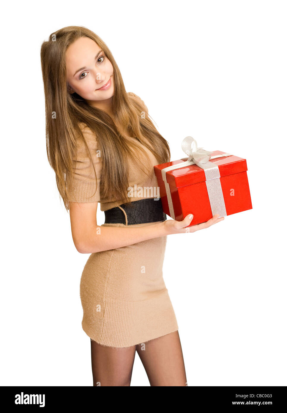 Half length portrait of a beautiful young brunette posing with bright red gift box, isolated on white background - Stock Image