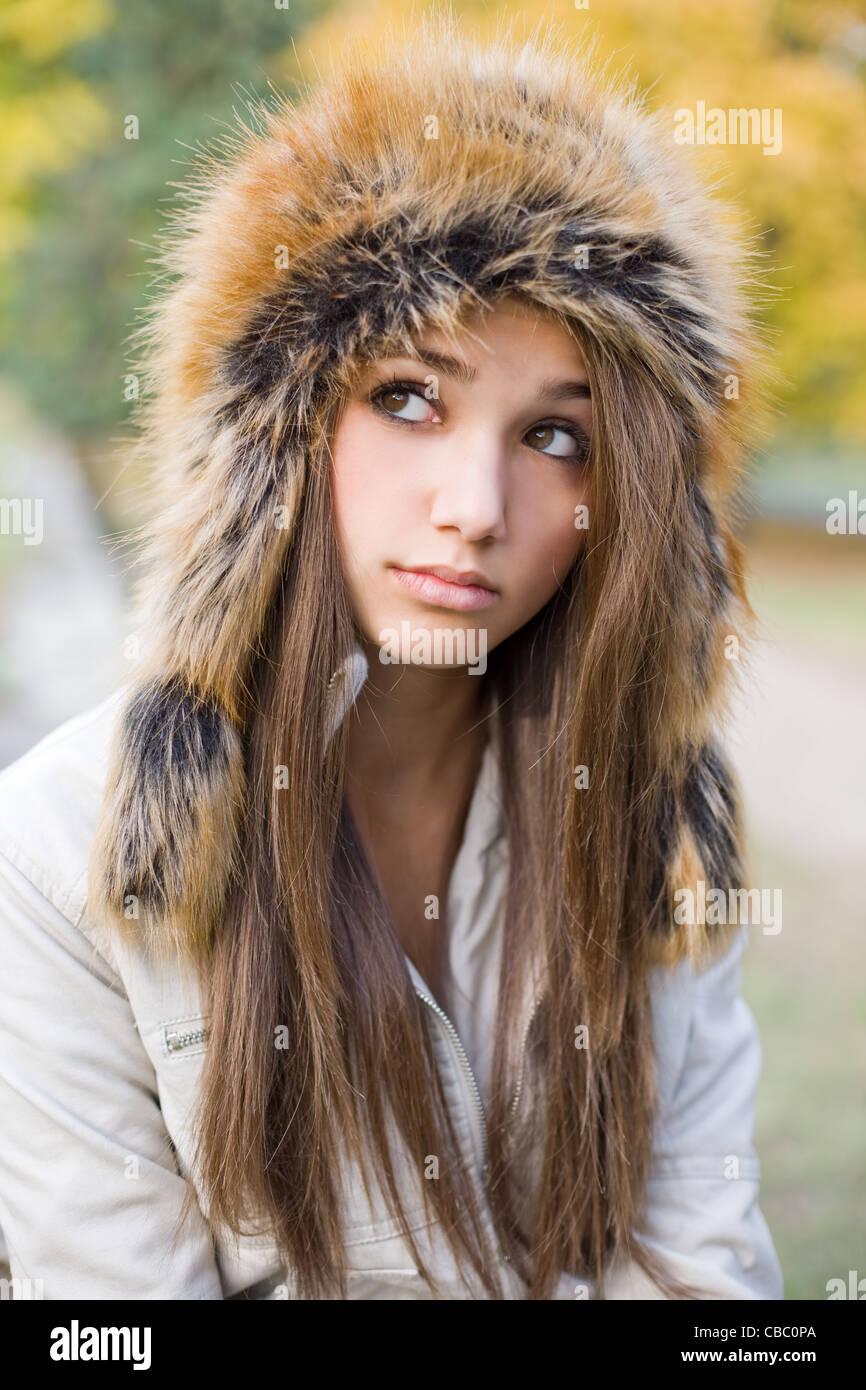 cute beautiful young brunette girl posing outdoors in big russian