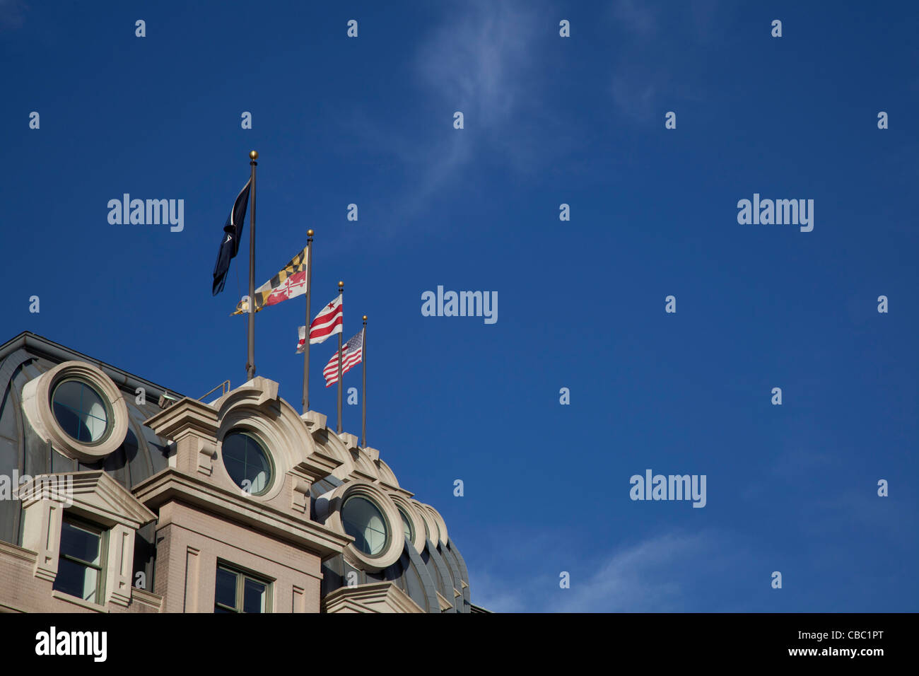 Washington, DC - Flags atop the Willard InterContinental Hotel, a luxury hotel around the corner from the White - Stock Image