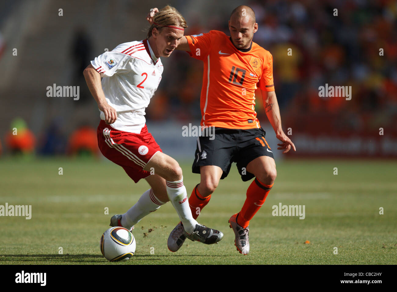 a970cc907ad Christian Poulsen of Denmark (L) keeps the ball from Wesley Sneijder of  Holland (