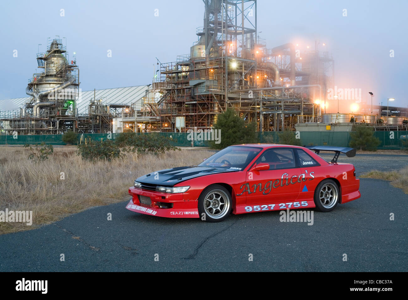 Nissan 180SX S13 Silvia Drift Motorsport Car Sitting Posed In Front An  Industrial Refinery   Stock