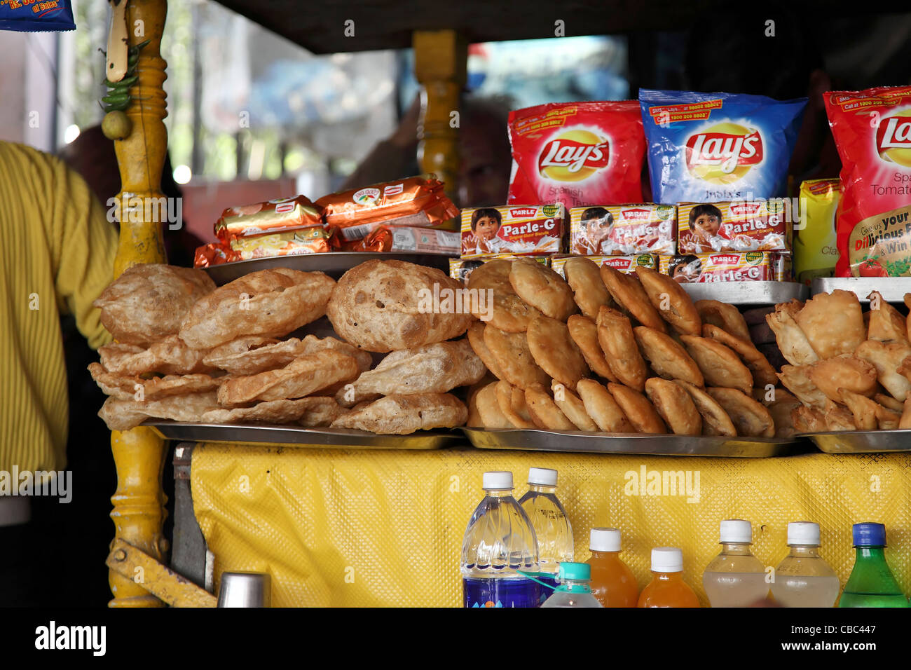 Indian Food stall,Food, more, store, bakery, gourmet, fried, window display, shelf, ladle, bun, tray, merchandise, - Stock Image
