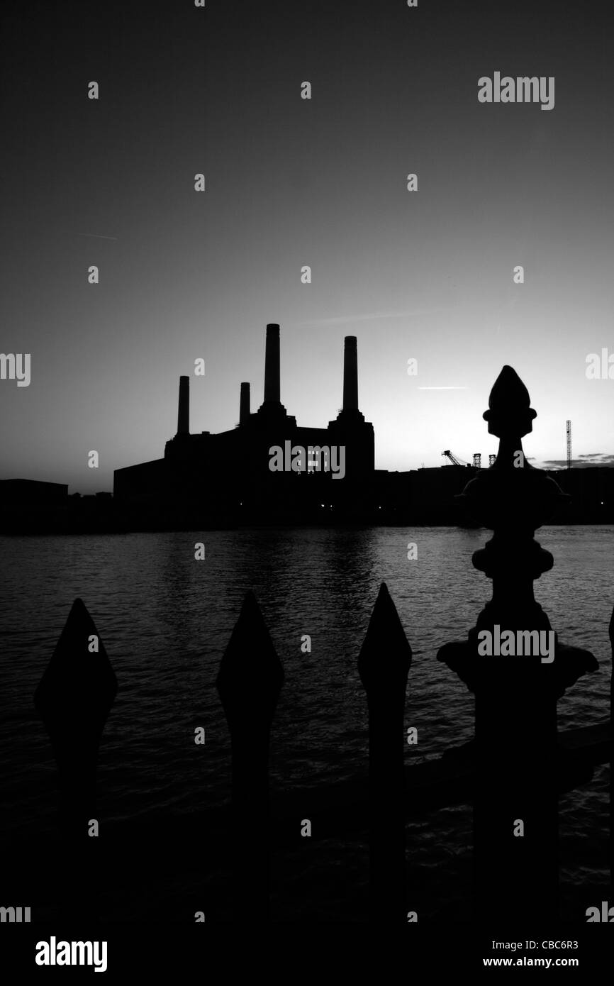 View across the River Thames to Battersea Power Station at dusk, Nine Elms, London, UK - Stock Image