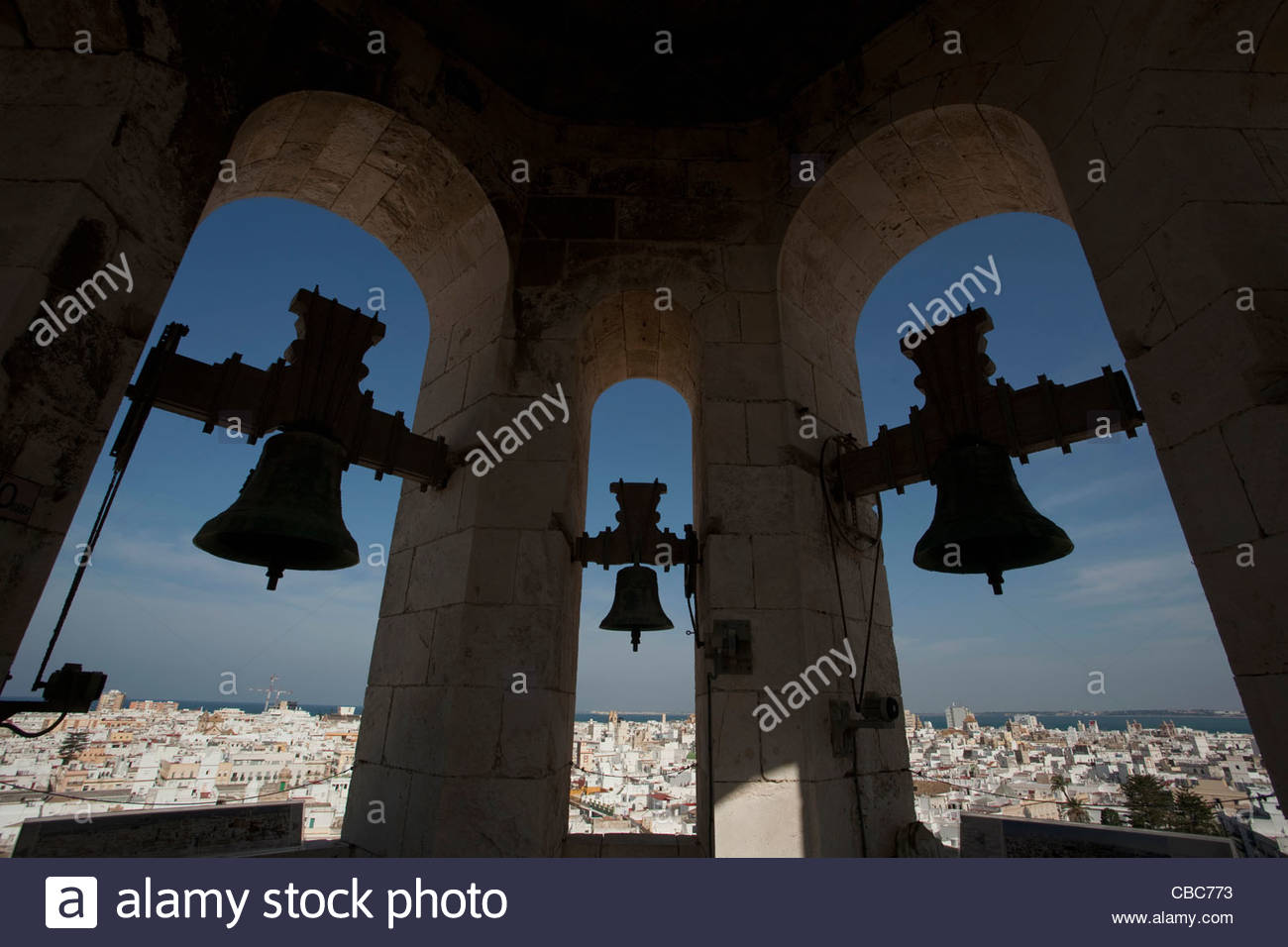 Bells hanging in chapel windows - Stock Image