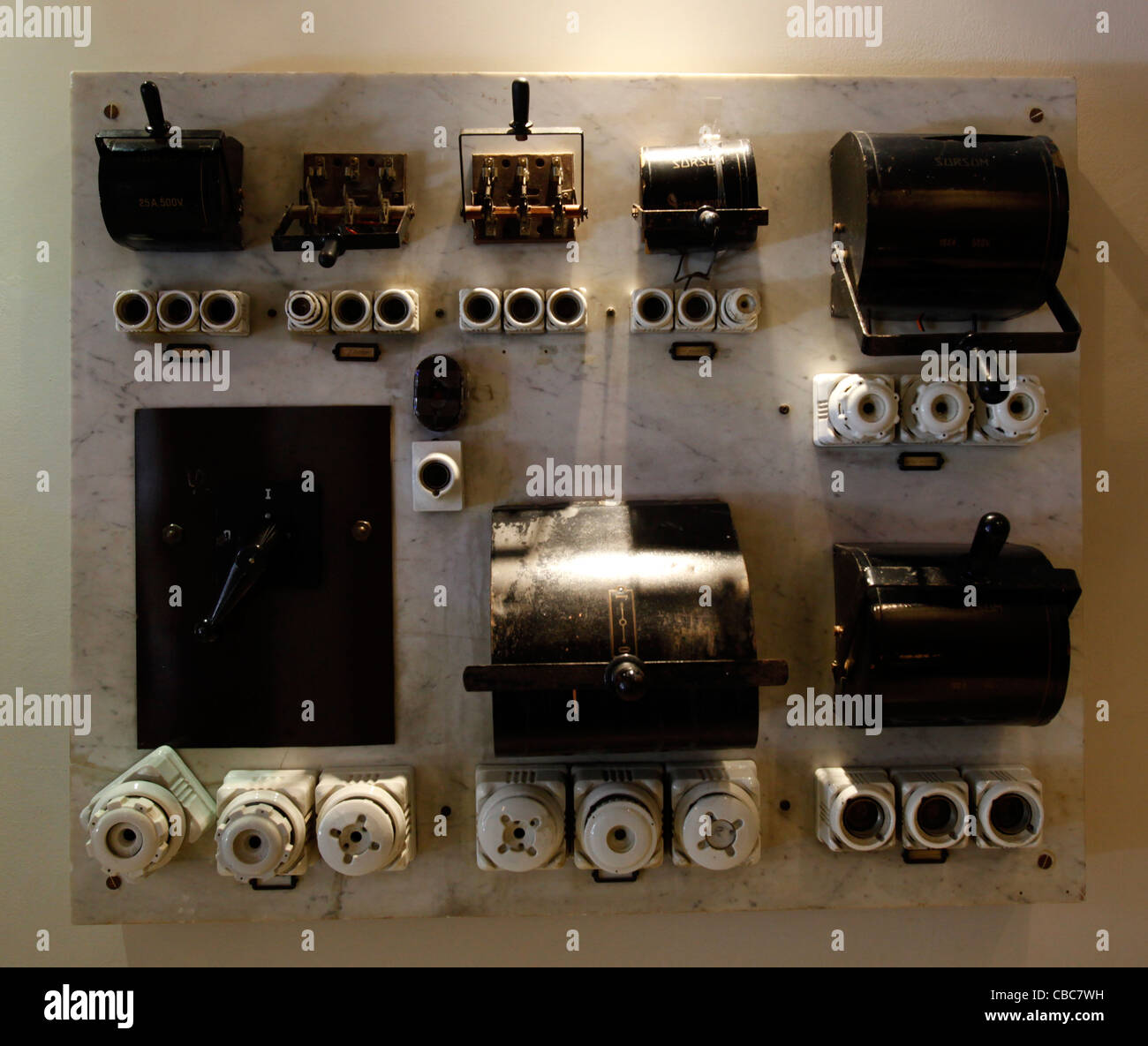 an old electric fuse box switchboard with ceramic fuses